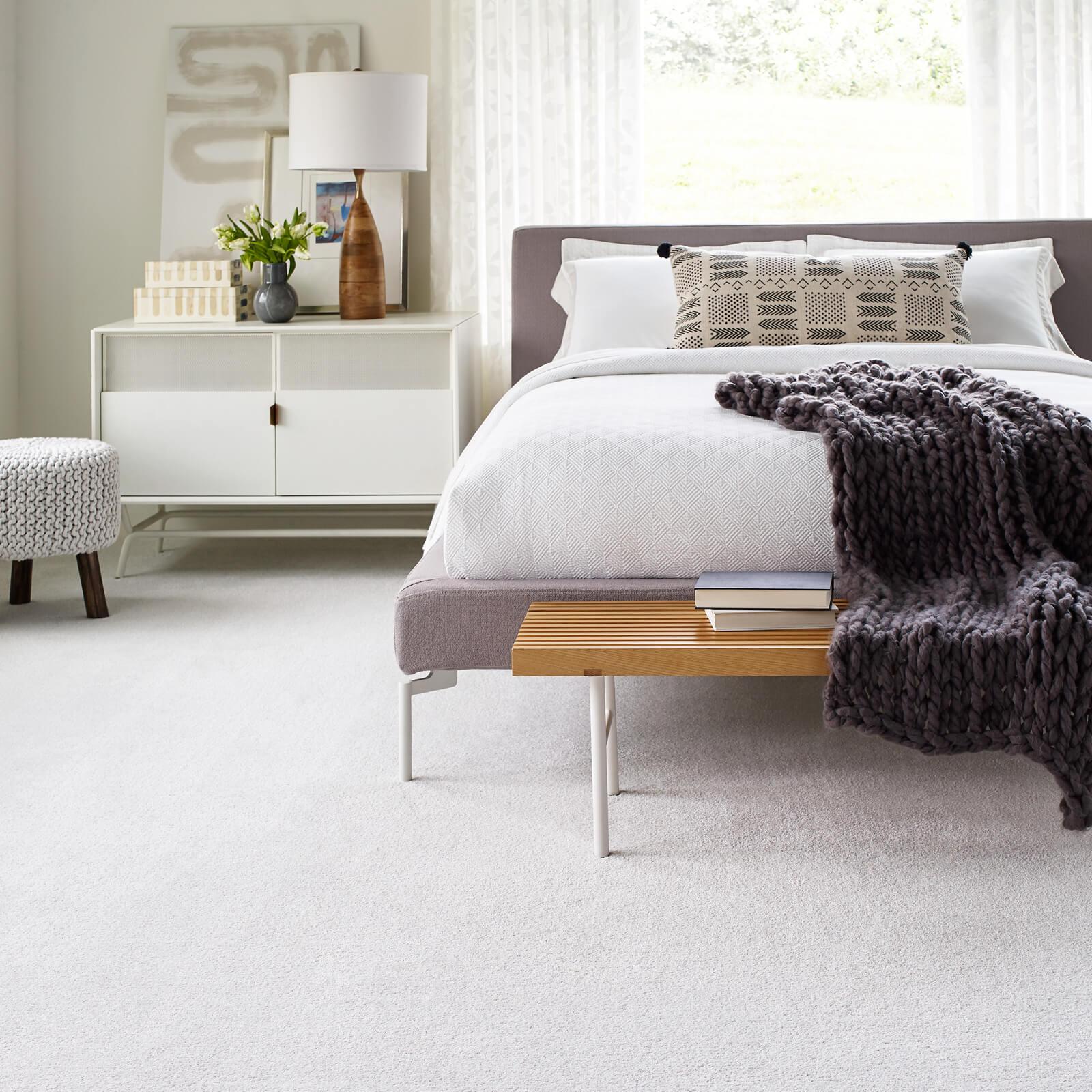 White carpet in bedroom | J/K Carpet Center, Inc