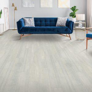 Blue couch on Laminate flooring | J/K Carpet Center, Inc