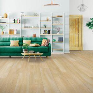 Green sofa on Laminate floor | J/K Carpet Center, Inc