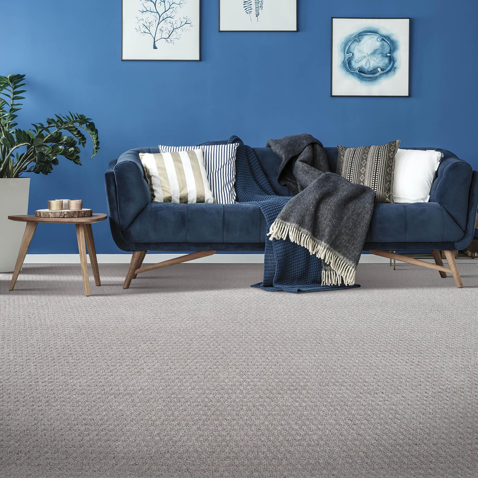 Blue couch on Carpet flooring | J/K Carpet Center, Inc