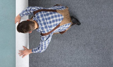 Man rolling Carpet | J/K Carpet Center, Inc