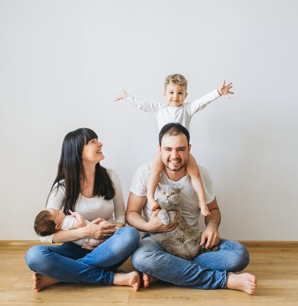 Family on Hardwood floor | J/K Carpet Center, Inc