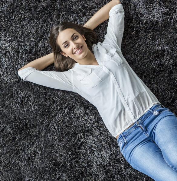 Lady on carpet | J/K Carpet Center, Inc