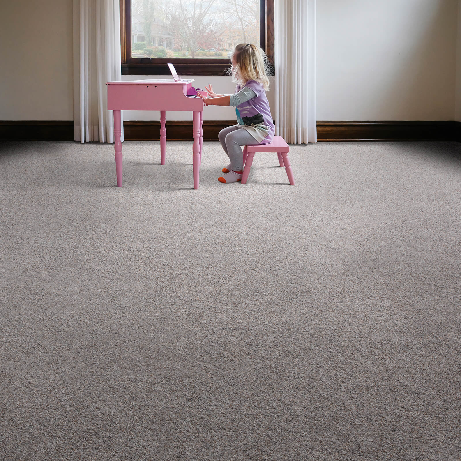 Girl with piano on Carpet flooring | J/K Carpet Center, Inc