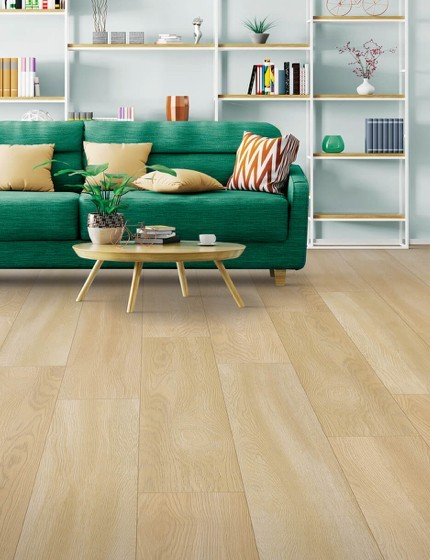 Green couch on Laminate floor | J/K Carpet Center, Inc