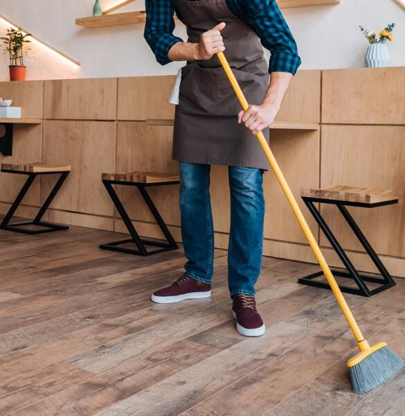 Sweeping hardwood floor   J/K Carpet Center, Inc