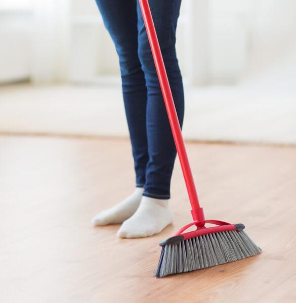 Sweeping laminate floor in Salem, OR | J/K Carpet Center, Inc