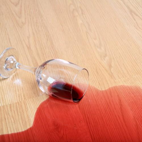 Wine spill cleaning on laminate flooring | J/K Carpet Center, Inc
