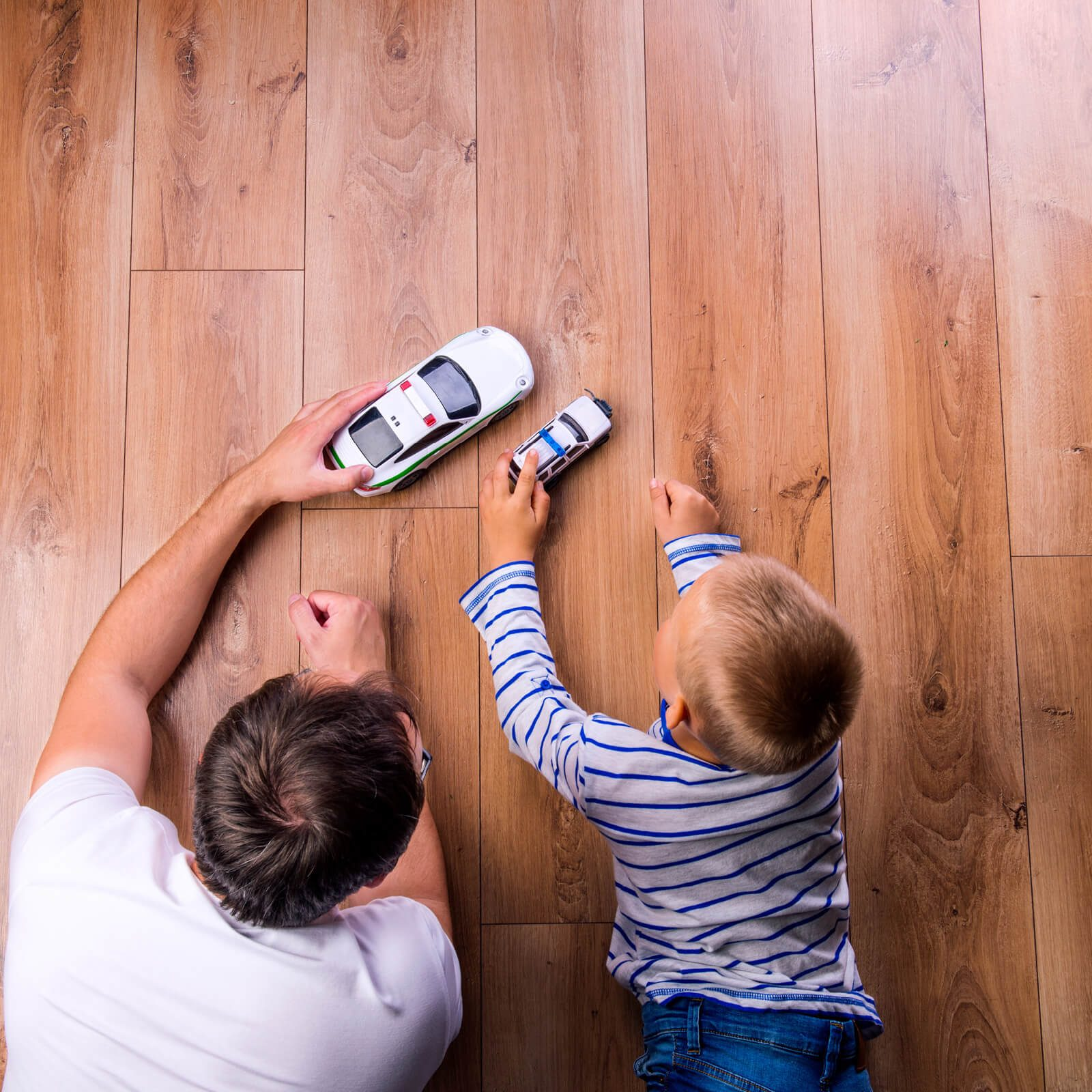 Father and kid playing with toycar | J/K Carpet Center, Inc